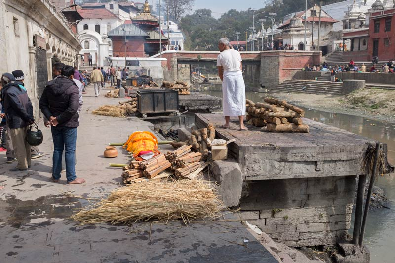 Preparing the cremation with a body by the platform at Pashupatinath, Nepal