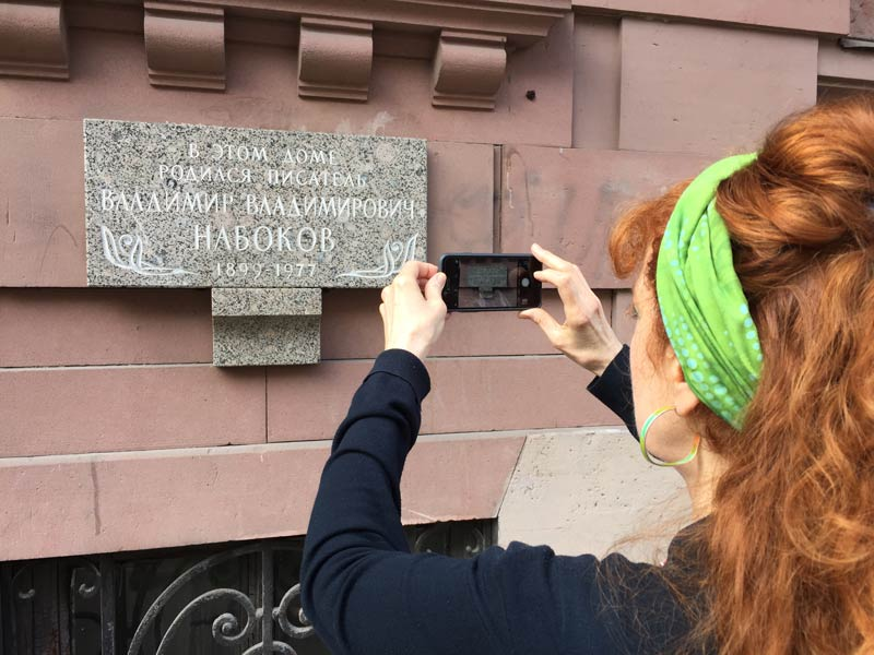 Tamara photographing the sign outside Nabakov's house in Saint Petersburg