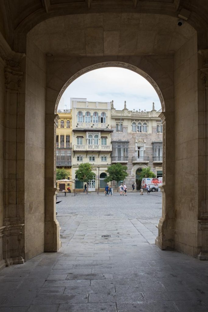 looking through an archway onto the Plaza de San Francisco in Seville - the first stop on our Andalusia trip