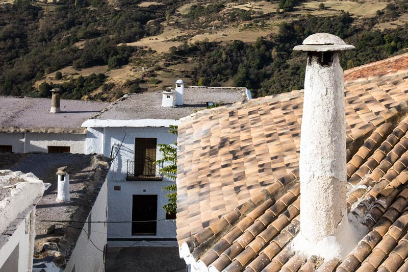 Capileira rooftops with characteristic chimney stacks