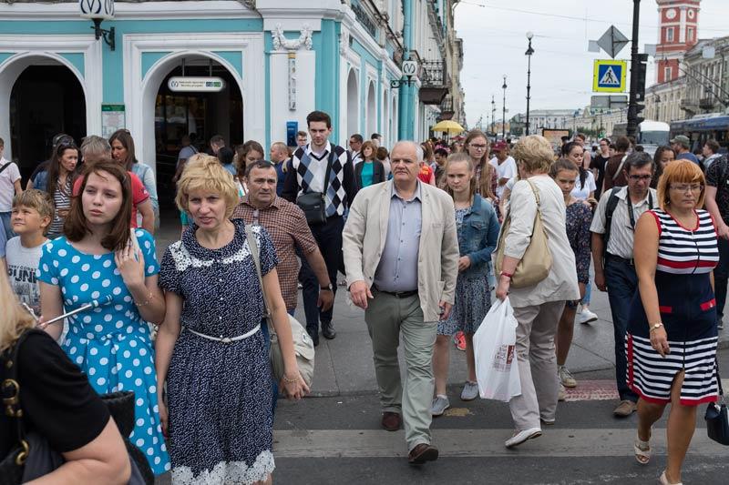 Pedestrians crossing the street on Nevsky Prospect in Saint Petersburg