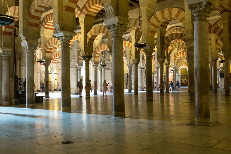the Mesquita palace - the grand mosque of Córdoba - with low, stone arches inside in contrasting red and cream supported on eight hundred columns.