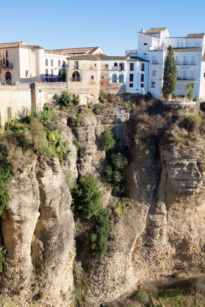 Houses clinging to the edge of the gorge that splits Ronda